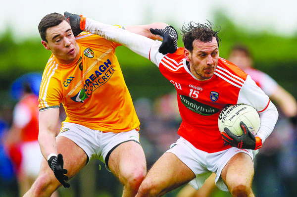 Antrim's Declan Lynch with Jamie Clarke of Armagh Mandatory Credit ©INPHO/Tommy Dickson