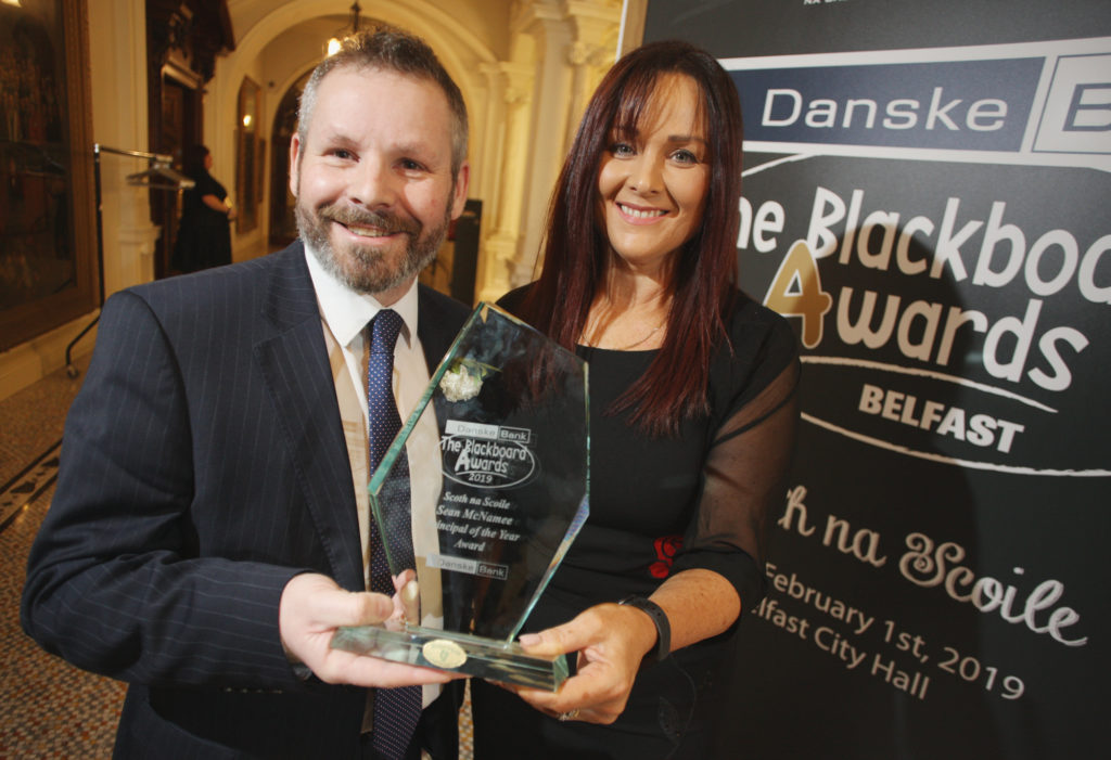 Sean McNamee from St Paul's Primary School is presented with the 'Principal of the Year Award' by Aisling Press (Danske Bank) at the 2019 Blackboard Awards in Belfast City Hall