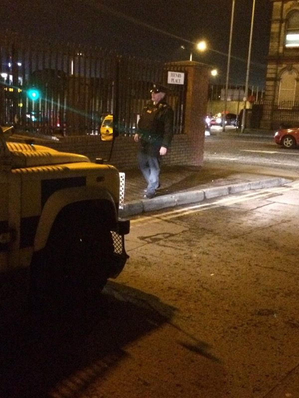 A PSNI officer in Henry Place on Tuesday night