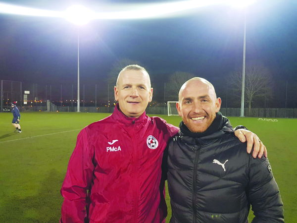 Cliftonville legend Barry Johnston, pictured above with Sport and Leisure Swifts manager Packie McAllister, has returned to his coaching role with the West Belfast outfit