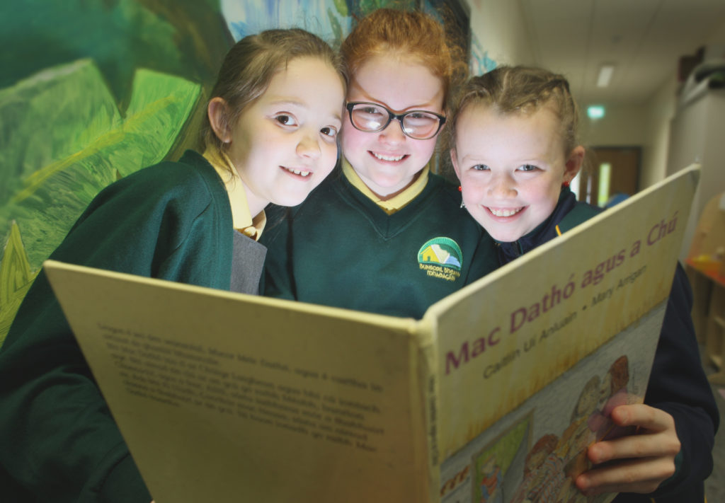 Catching up on a bit of light reading are Bunscoil Bheann Mhadag‡in pupils Aoibhe Clarke, Cadhla O' Riordan and Clodagh Brownlee