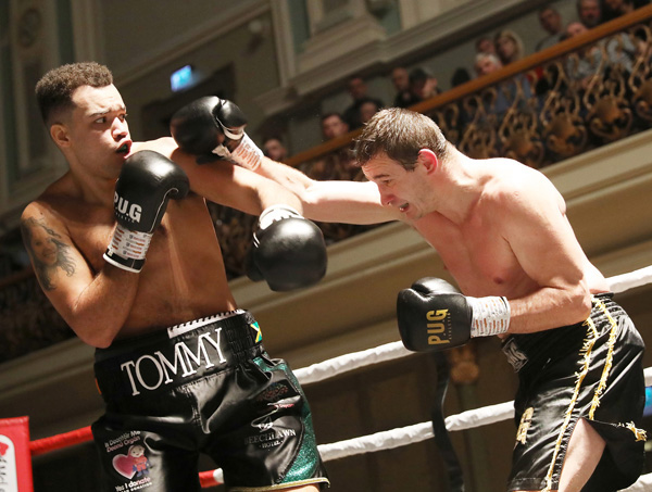 On the 'Night to Remember' bill at the Ulster Hall on Saturday night, cruiserweight Tommy McCarthy – sporting a Dáithí Mac Gabhann organ donation logo on his shorts – slips a looping right hand from Juri Svacina of the Czech Republic. The West Belfast man won comfortably on points   Tommy McCarthy v Jiri Svacina
