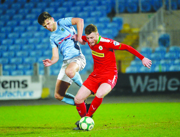 Ballymena's Adam Leckey challenges Cliftonville's Joe Gorman during Tuesday's win for the Braidmen