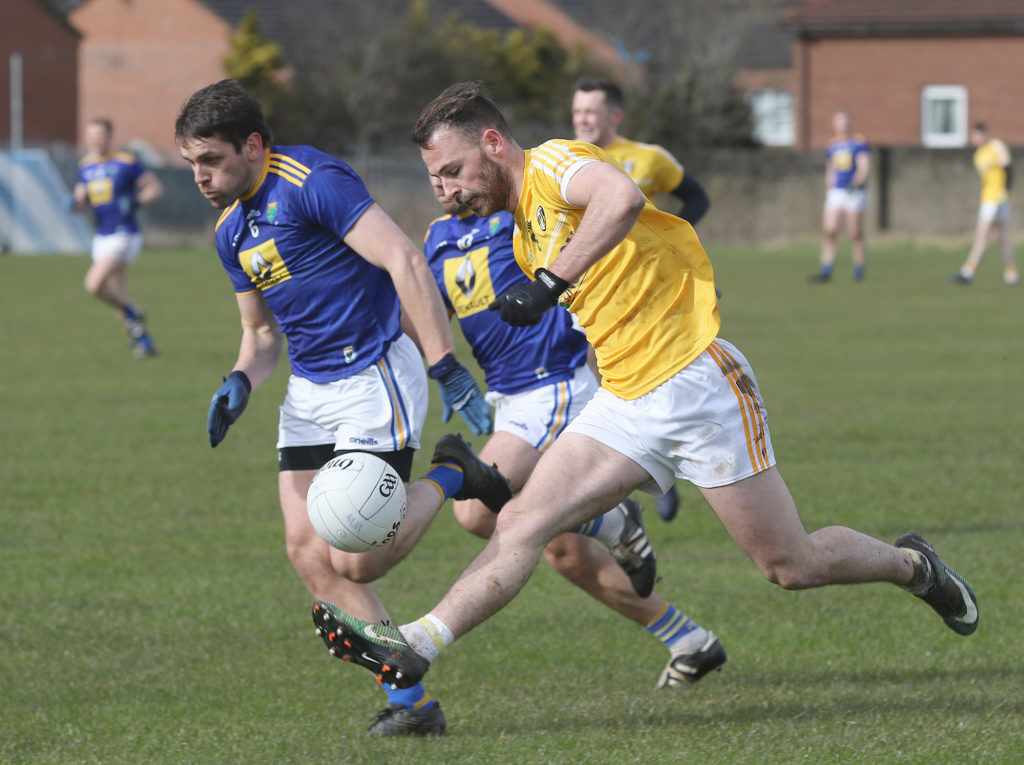 Antrim's Matthew Fitzpatrick, who scored 2-3 for his side, solos clear of Wicklow's Shane Mooney during Saturday's 11-point win for the Saffrons at Corrigan Park