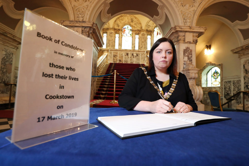 Lord Mayor, Councillor Deirdre Hargey signs the Book of condolence at Belfast City Hall