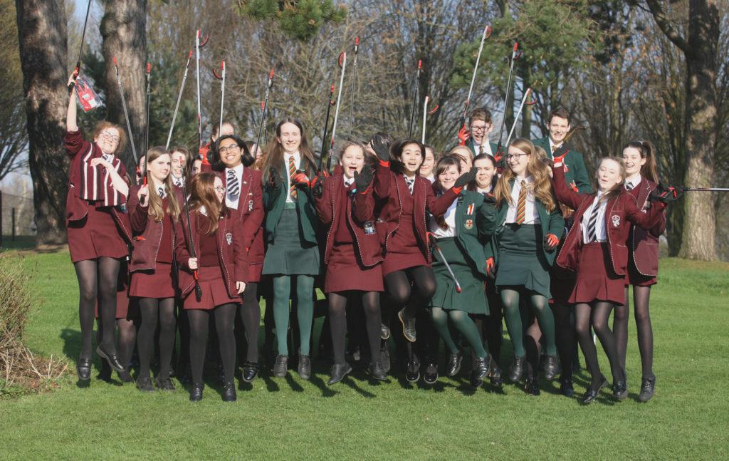St Dominic's Grammar School and Friends' School Lisburn girls taking part in a litter pick in the Falls Park