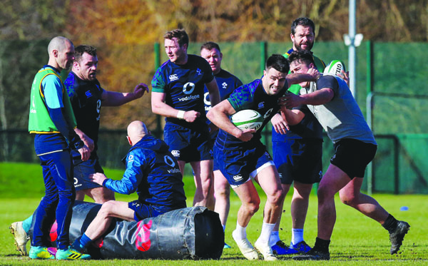 Conor Murray slips a tackle during last week's training session at The Dub