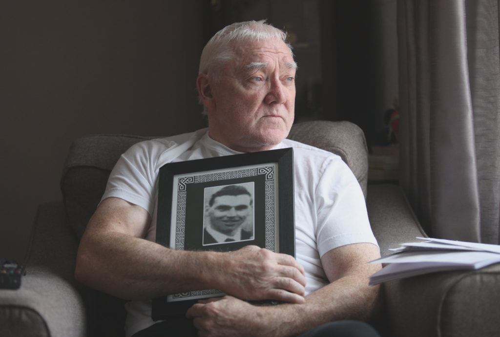 COURT CASE: Anthony Thompson with a treasured family portrait of his brother David