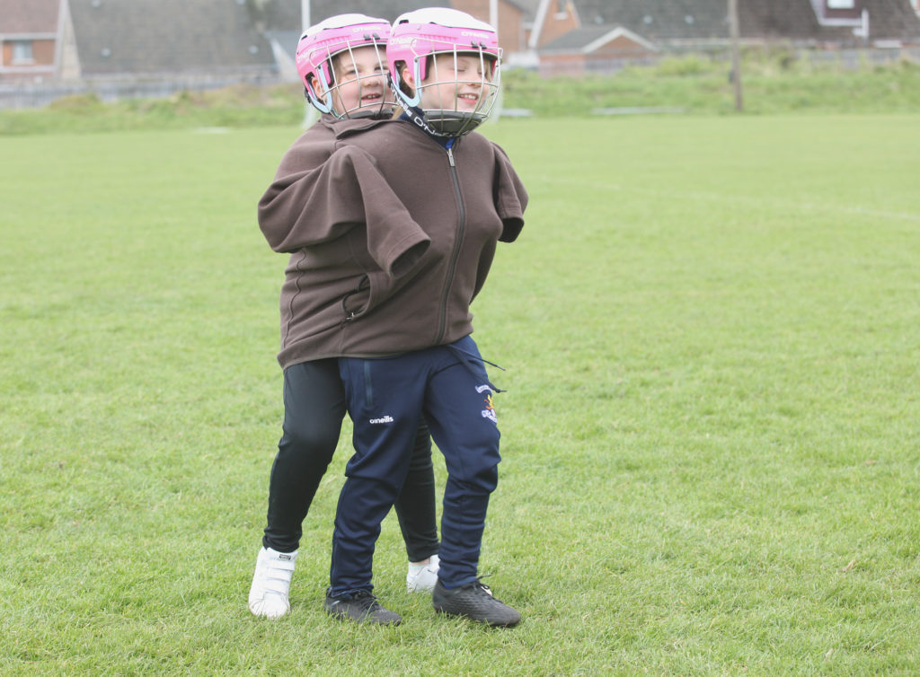 CHILD'S PLAY: Two youngsters keep warm during an under-8s camogie tournament at Sarsfields  CLG