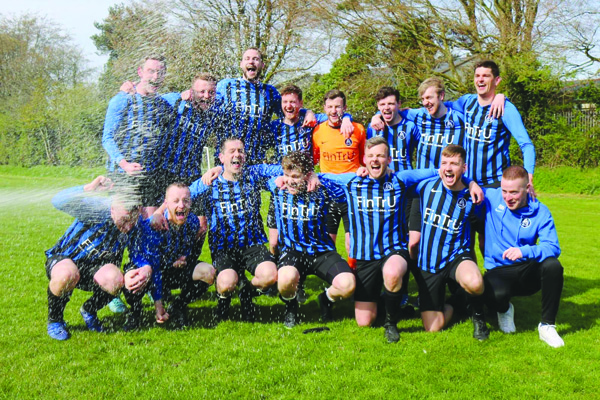 Aquinas celebrate following their promotion to Division 1B after winning Division 2A in their first season as an Intermediate side
