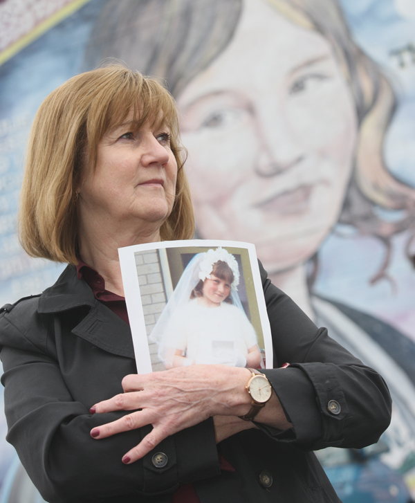 SECRETS: Elizabeth Livingstone at a Lenadoon mural tribute to her sister Julie