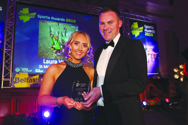 St Malachy's OB and Ardoyne Kickhams coach, Laura Vernon picks up her Young Coach of the Year award from Gareth Kirk, GLL, at the recent Belfast City Council Sports Awards at the City Hall