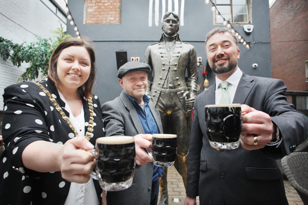 Toasting the new Henry Joy McCracken statue at the Jail House in Joys Entry are sculptor Steve Finney, Lord Mayor Deirdre Hargey and Christopher McCracken, a descendant of the legendary United Irishman
