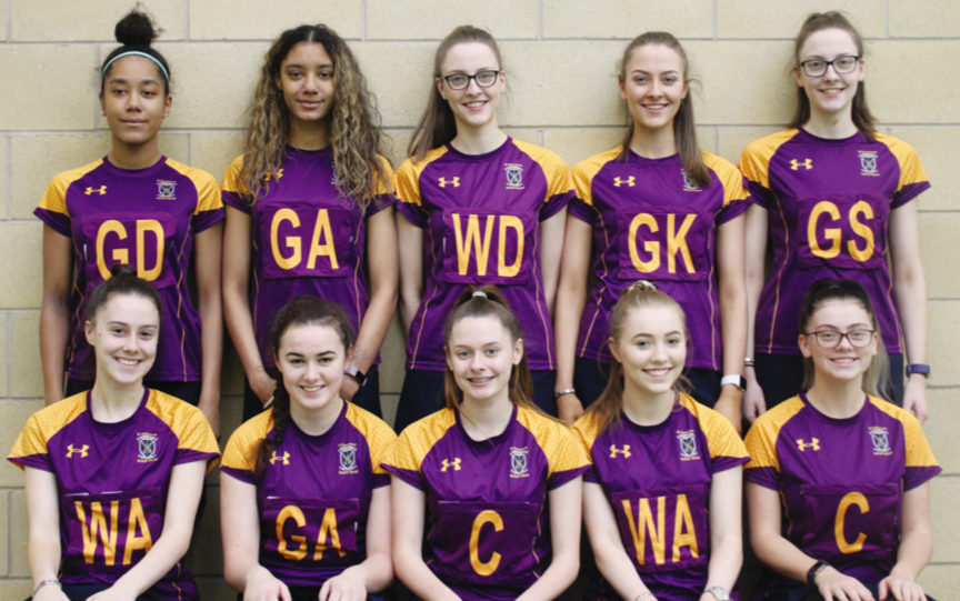 The St Genevieve's team (above) and showing off new training tops