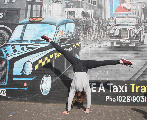 French student Anouk Limonne is full of the joys of spring on a visit to the International Wall