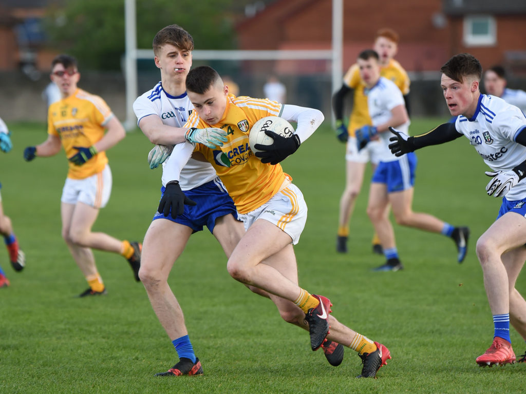 Antrim defender Michael Ferris comes under pressure from Monaghan's Karl Gallagher during Saturday's Ulster Minor Football Championship clash at Corrigan Park with the Farneymen claiming a narrow one-point win