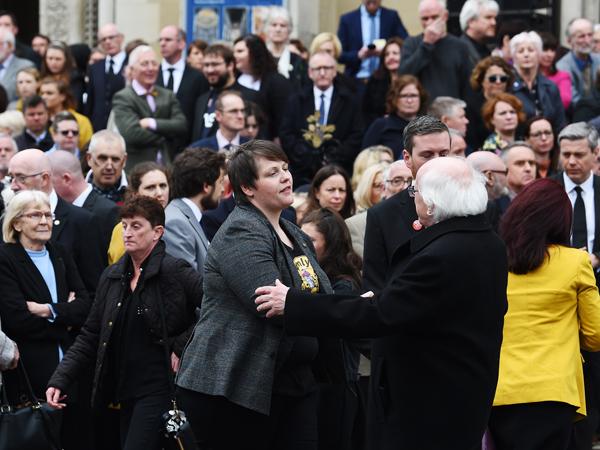 President Michael D Higgins consoles Lyra McKee's partner Sara Canning