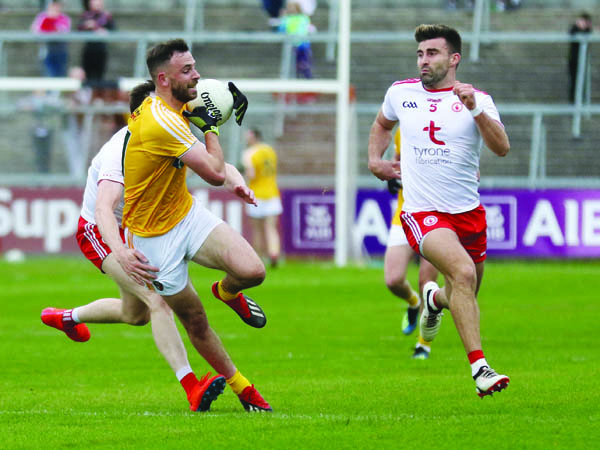 Antrim's Matthew Fitzpatrick, pictured in action against Tyrone pair Colm Cavanagh and Tiernan McCann, feels the time is right for a tiered Championship format in football