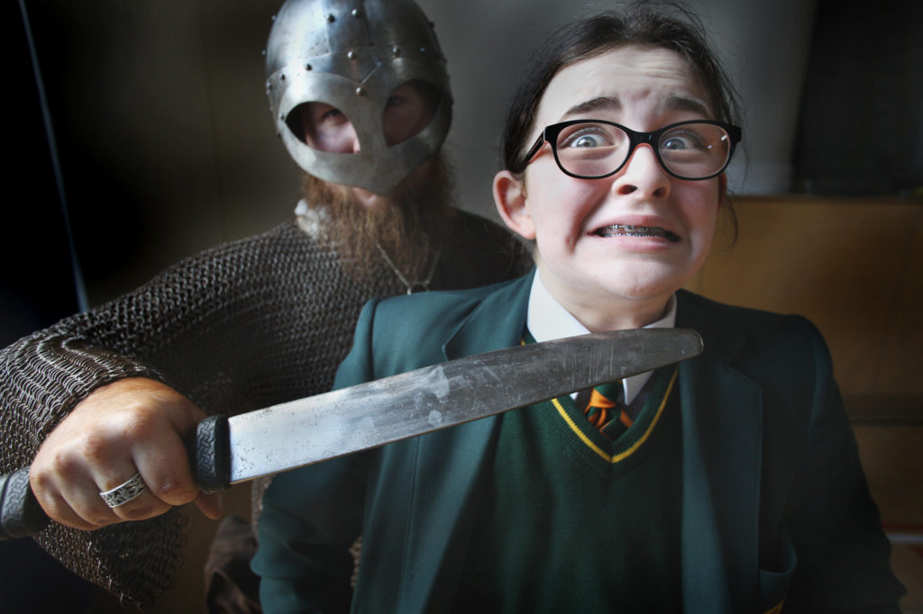Lucy-May up and close with the Vikings at Coláiste Feirste when they visited the Falls Road school for a slice of living history