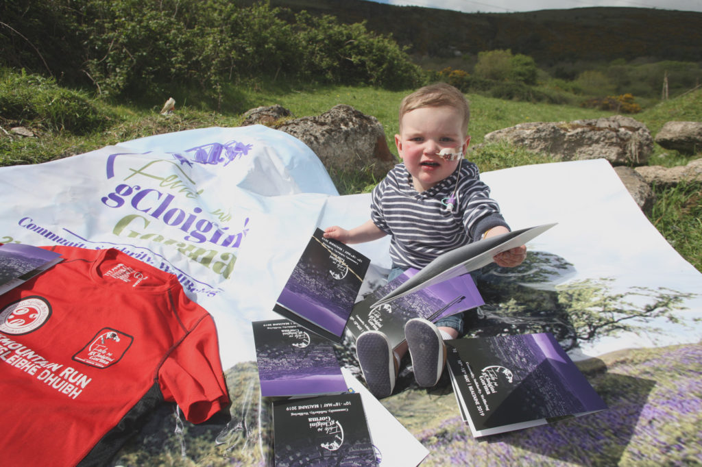 Little Dáithí helps with preparations for the mountain walk