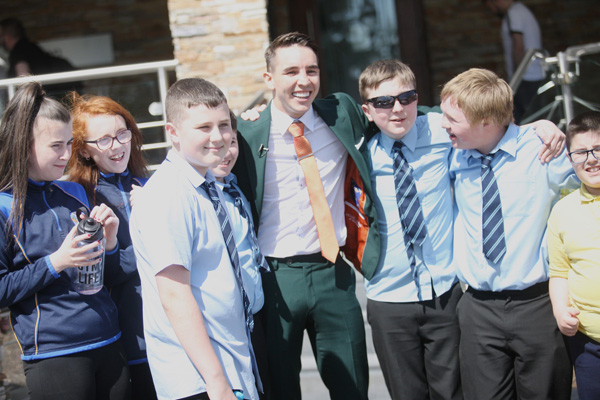 Stepping out from the media whirlwind that has greeted his Falls Park Féile fight announcement, Michael Conlan met students from St Gerard's at the Balmoral Hotel