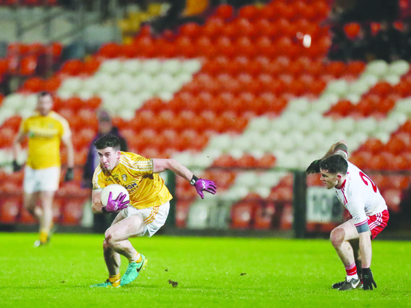 Antrim's Ryan Murray gets away from Tyrone defender Brendan Burns during the Dr McKenna Cup clash between the sides at the Athletic Grounds in January of last year. The sides return to Armagh for Saturday evening's Ulster Senior Football Championship quarter-final