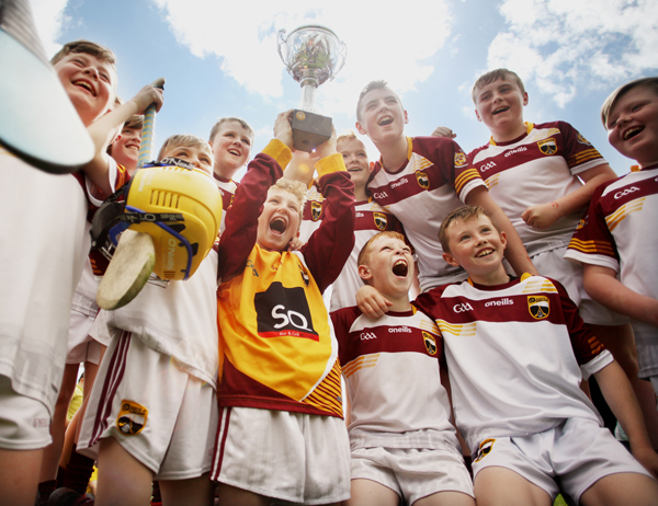 Delighted young Bunscoil Tsléibhe Dhuibh hurlers celebrate their Antrim Schools Final victory at Musgrave