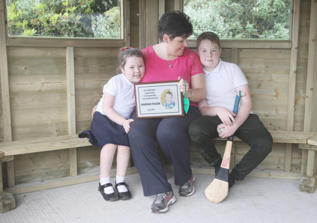DIARMUID'S LEGACY: Tina Frazer, her son Cormac and daughter Orlaith in the new outdoor classroom
