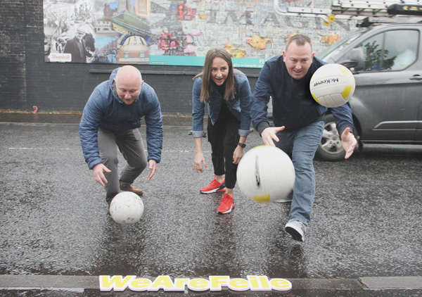 Conor Barnes (Ardoyne Kickhams), Jane Adams (Manny's) and Gerard Mulhern (PG) in Northumberland Street for the launch of the Féile an Phobail Cribby World Cup Competition
