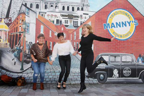 A trio of Yorkshire lasses get into the spirit of Belfast in Bank Square