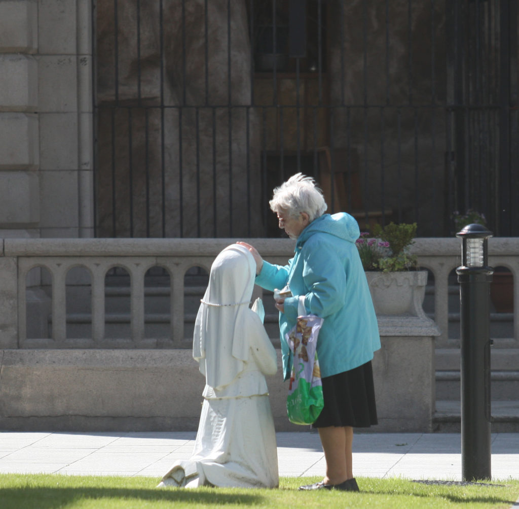 Taking a moment for prayer at St. Mary's Church on Chapel Lane