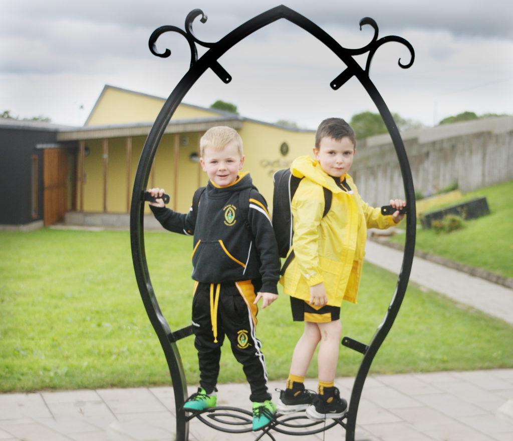 Pal Caílte Quinn and Jarlath Kearney have a bit of fun before another day begins at Gaelscoil Éanna