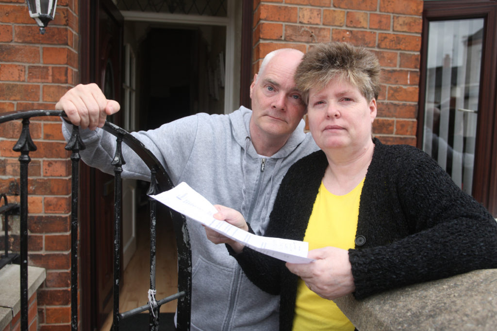 HAND IT OVER: Catherine and husband Anthony McLaughlin with the savage repayment demand