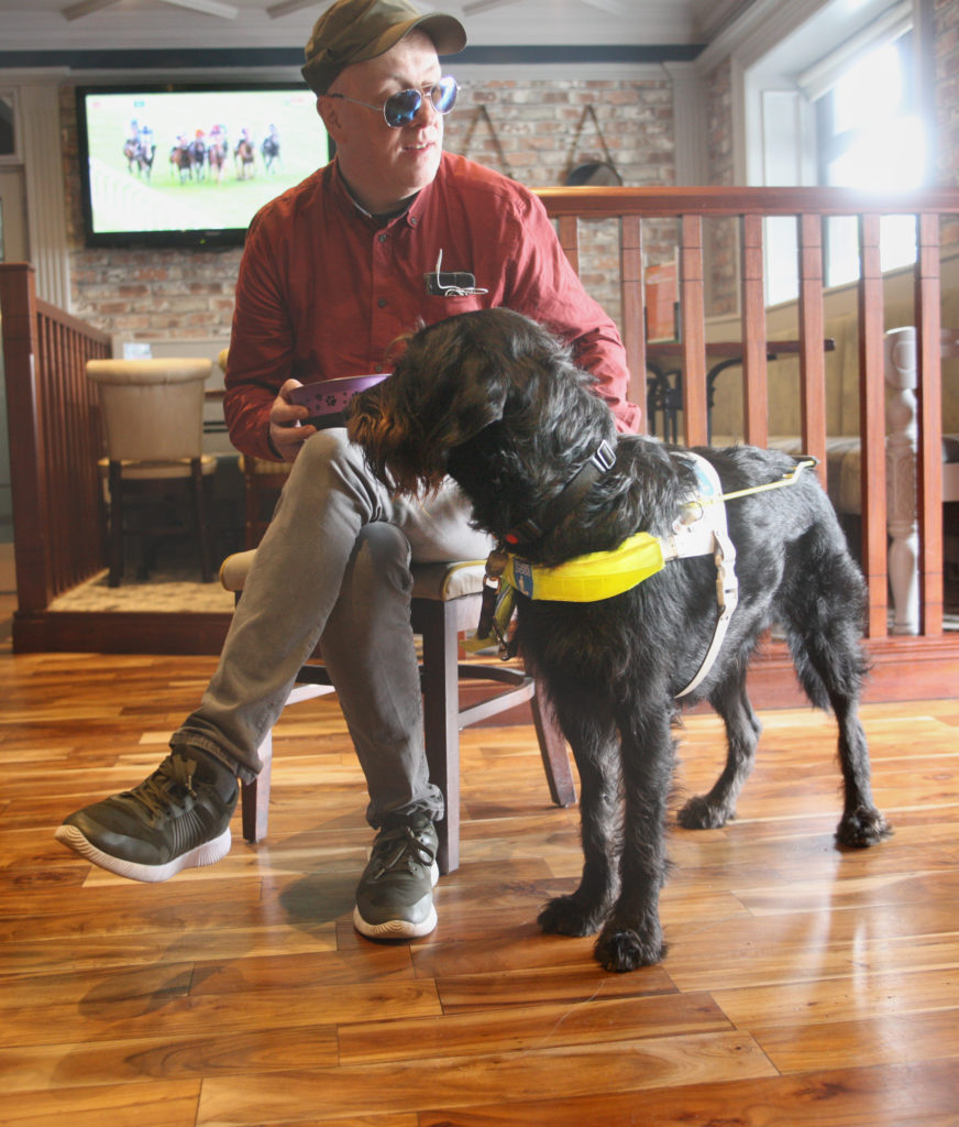 TEAM: The Balmoral Hotel's Colm Glover with his guide dog Obi in the Greenan Bar