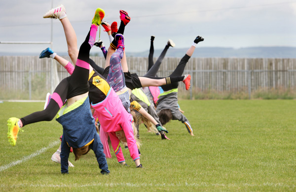 Cartwheeling for joy as school ends and summer begins at the Naomh ƒEanna Cuœl Camp in Glengormley
