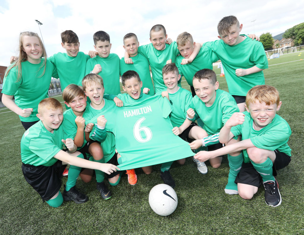 Young St Patrick's FC players at the Girdwood Hub for the club's Family Fun Day and BBQ to remember Seanboy Hamilton and celebrate his life