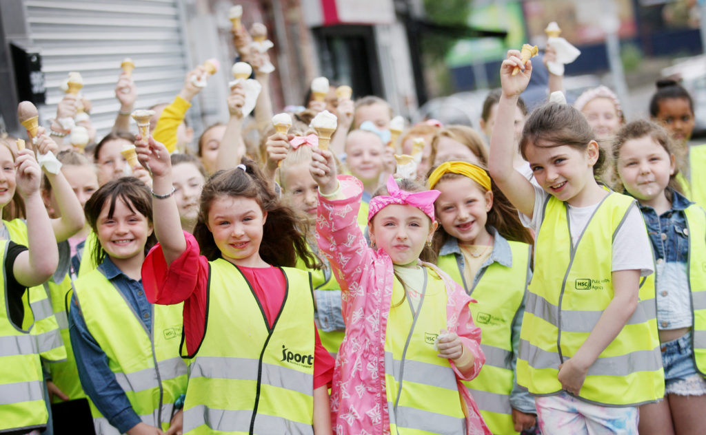 Girls from Mercy PS Summer Scheme in Ardoyne cool down with ice cream as the temperature rose