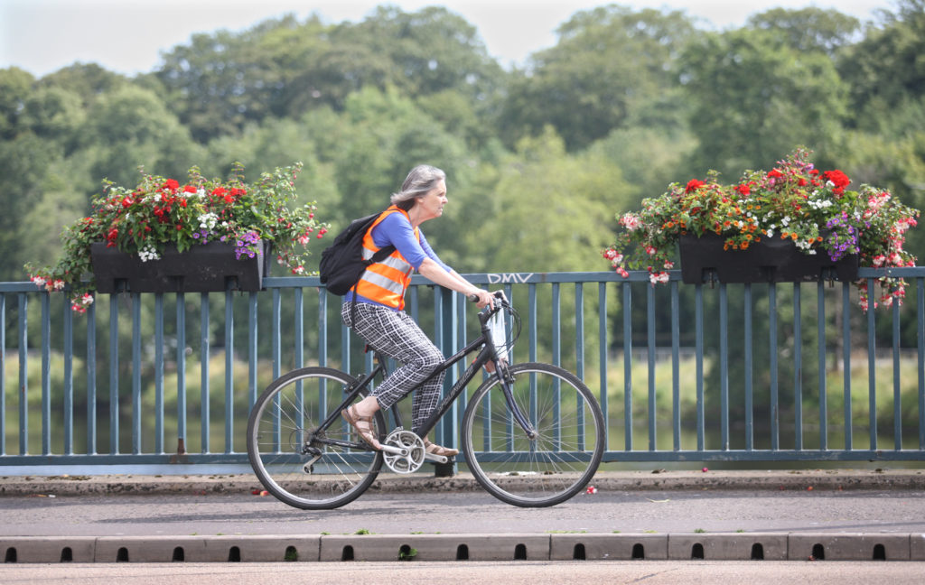 ON YOUR BIKE: A cyclist crosses a sun-soaked Ormeau Bridge