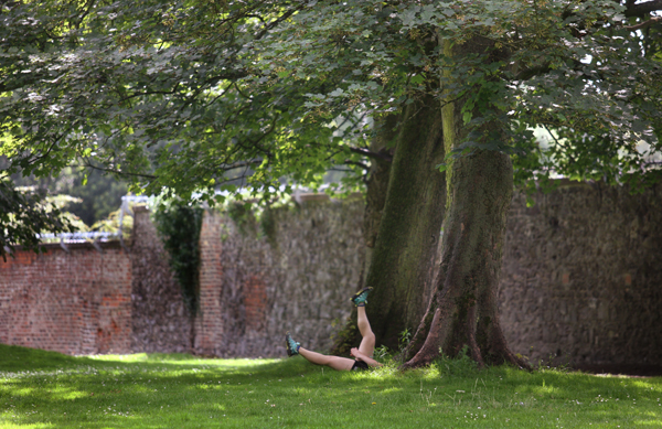 PULL THE OTHER ONE: A jogger stretching before a summer workout in the Ormeau Park