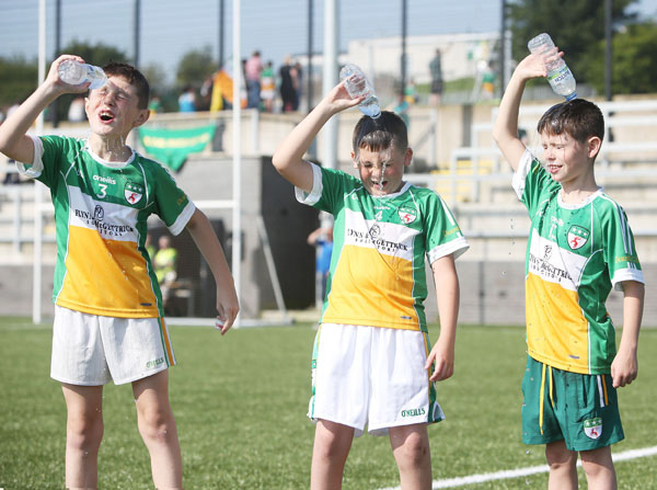 Ronan McNally, Adam Gilliland and Karl O'Hara cool off in hot sunshine during yesterday's Davitt's GAC U10 Memorial Tournament at Coláiste Feirste