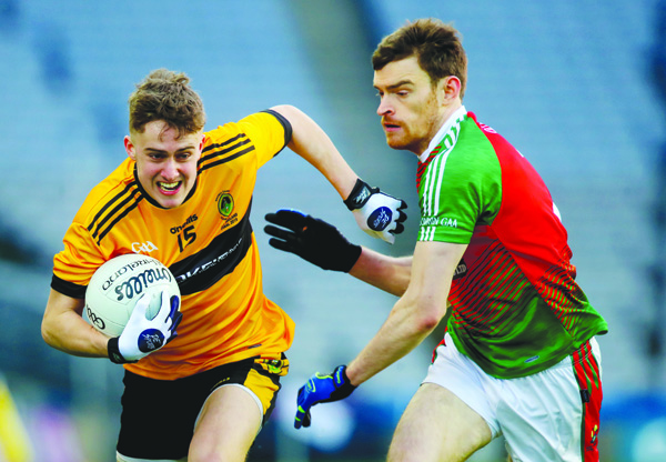 Eoin Nagle, pictured in action against Kilcummin of Kerry in February's All-Ireland IFC final at Croke Park, is expected to return to the Naomh Éanna team for Saturday's Antrim Senior Football Championship preliminary round clash against Aghagallon at Glenavy