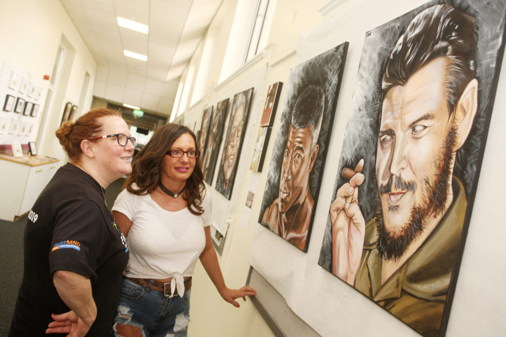 Visual arts co-ordinator Deirdre Mackel and Féile Operations and Events Co-ordinator Áine McCabe view some of the many pieces on display at St Mary's