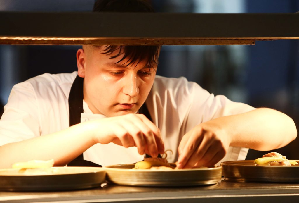 Young chef Harry Barkley puts the finishing touches to his dish of salmon and cod at the pass in the Balmoral Hotel kitchen. Harry scored a double triumph on the night, scooping the People's Choice award (voted for by the audience who sampled a taster of the food of all four finalists) and he was declared the overall winner by a panel of four distinguished judges. Harry weaves his culinary magic at Brothers restaurant in Ballyclare.