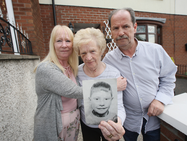 JUSTICE: Patrick Rooney's mother Alice with her son and daughter Con and Sharon, holding a photo of Patrick who was shot dead by the RUC in August 1969