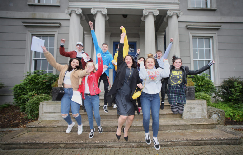 Hazelwood Integrated College pupils celebrate their GCSE results with Principal M‡aire Thompson