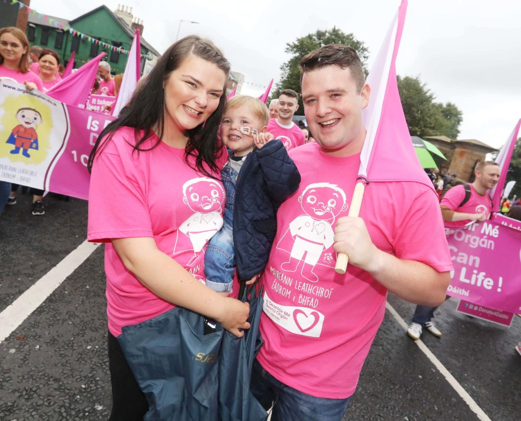 The Falls Road was awash with pink on Saturday for West Belfast toddler Dáithí Mac Gabhann and his parents Máirtín and Seph. The Whiterock two-year-old was grand carnival marshal for the annual Féile an Phobail parade which supported the family's 'Is Deontóir Mé/Yes I Donate' campaign.