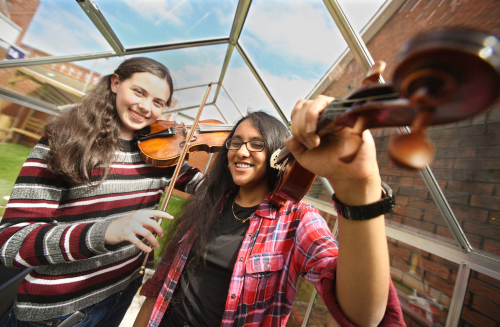 TUNING UP: Sarah Brown and Sushmitha Ponsailapathy of the Andersonstown School of Music getting ready to play at the Springfield Charitable Association