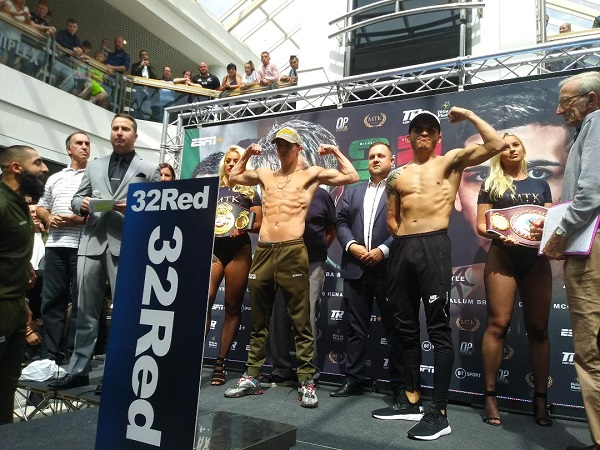 Michael Conlan and Diego Ruiz salute the crowd after weighing-in at the Kennedy Centre at lunchtime