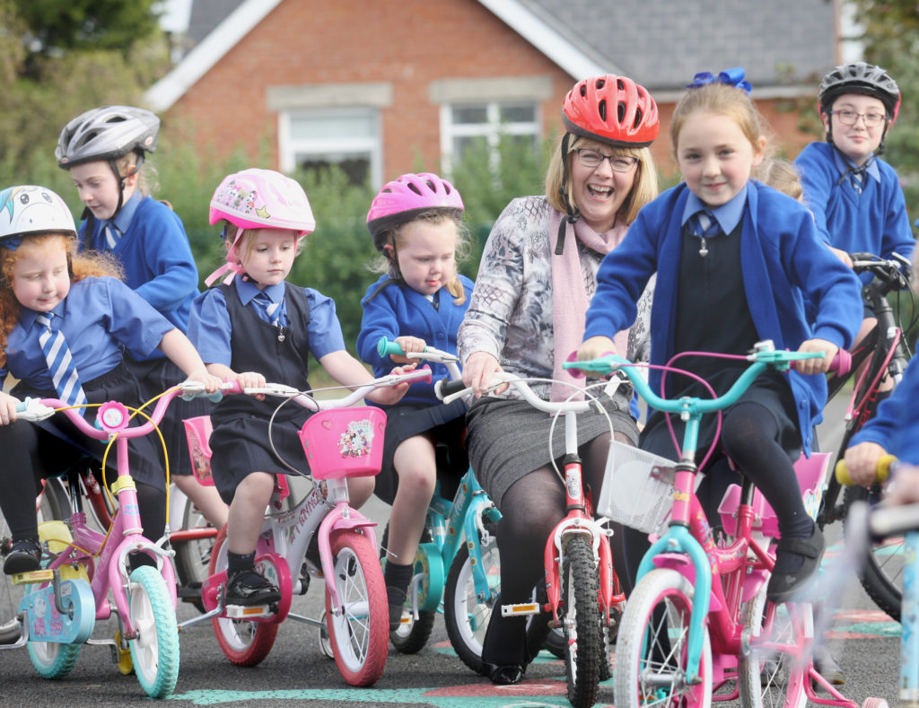 Principal of Mercy Primary School Elaine Loughran leads the way as part of Ride Your Bike To School Week
