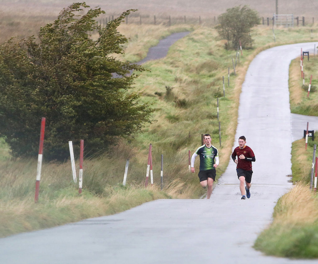Runners on Divis Mountain battle the gradient in wet and blustery conditions